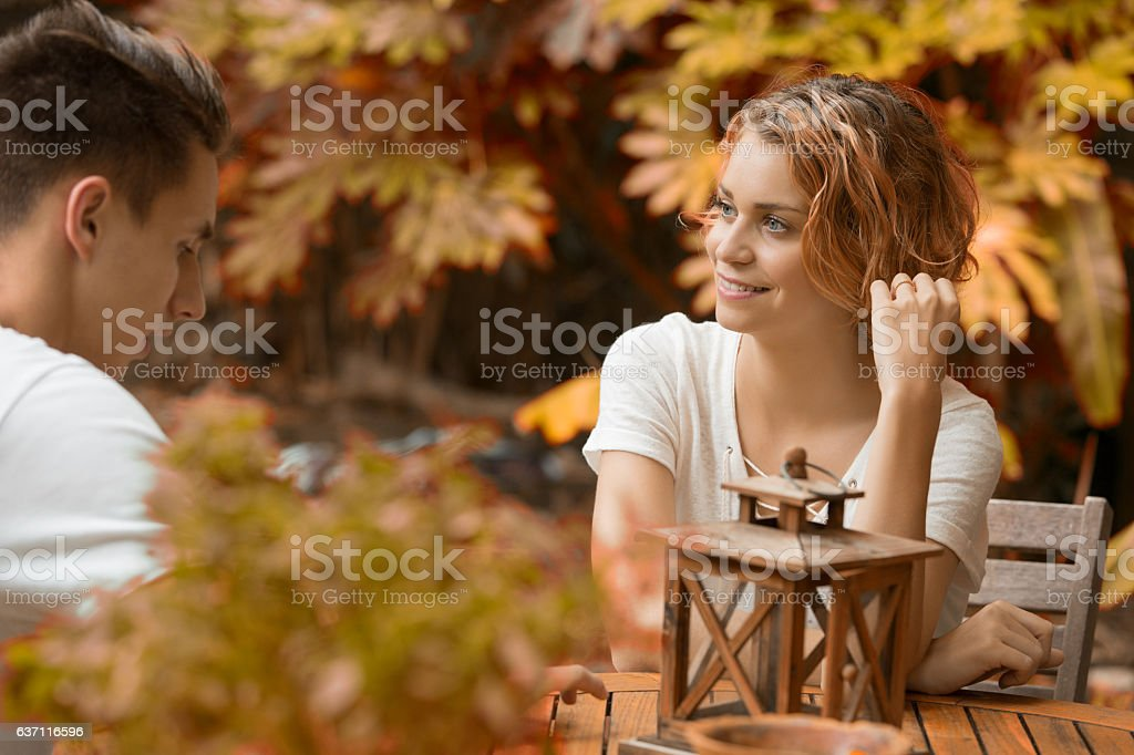 young happy beautiful couple speaking automn time - foto de acervo