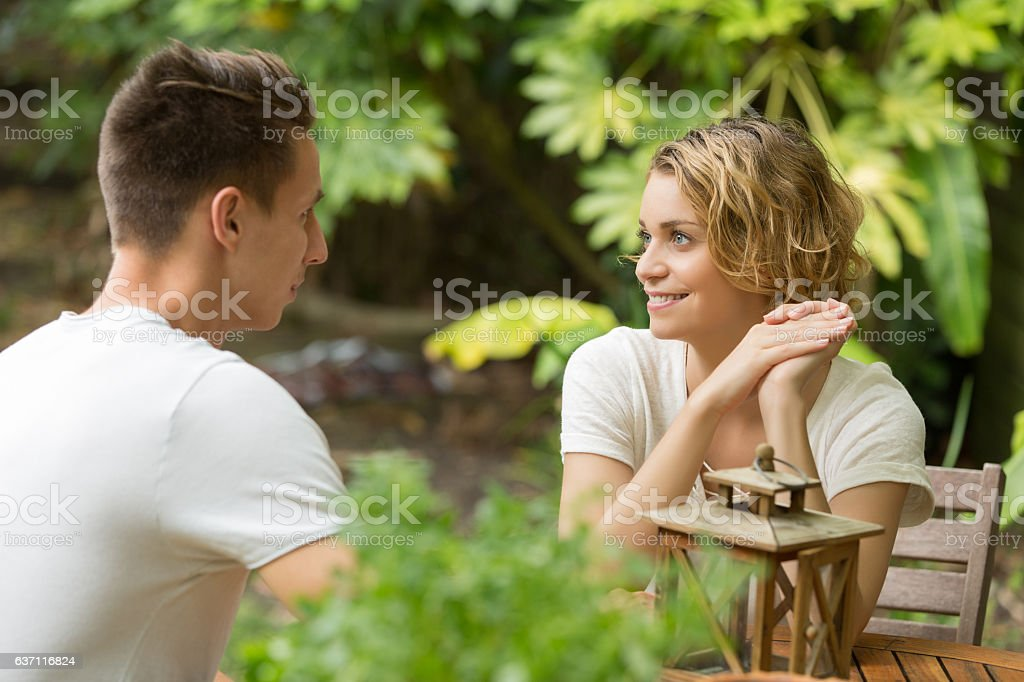 young happy beautiful couple speaking summer time - foto de acervo
