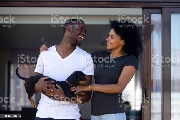 Young happy black couple embracing having fun with pet outdoors picture id1126384616?b=1&k=6&m=1126384616&s=612x612&h=b1lbz zau7zs8ifpkxtqkdpoxilfz2j9ig7pqezb 9c=