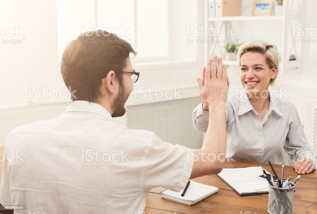 Young happy business partners in office royalty-free stock photo