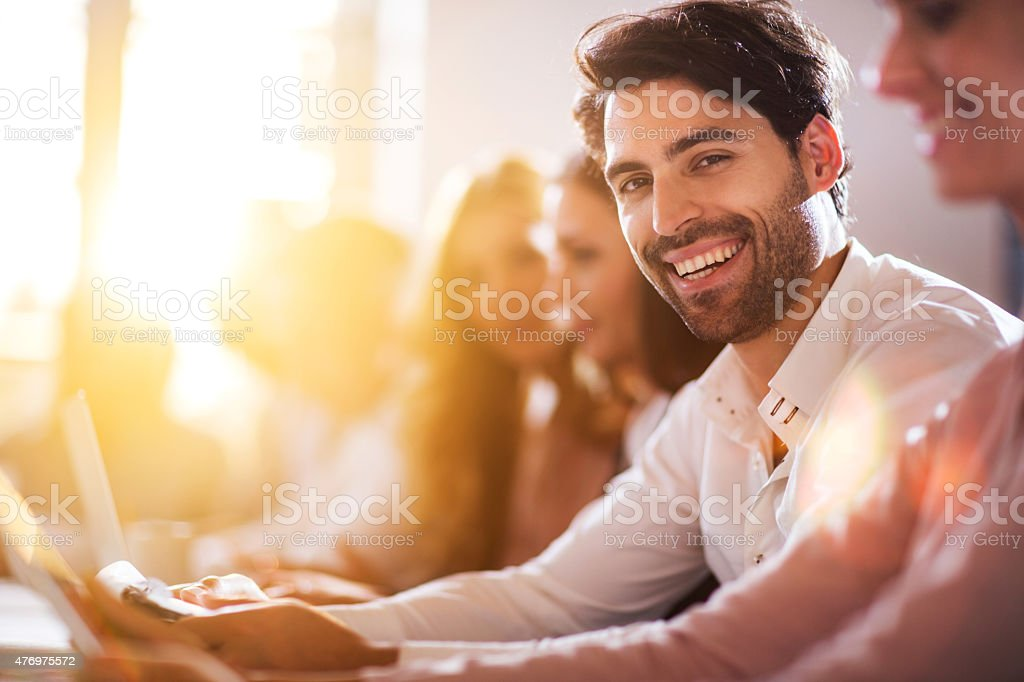 Young happy businessman on a meeting in the office. stock photo