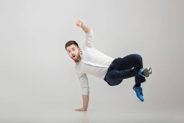 young happy businessman with beard in shirt break dancing on – Foto