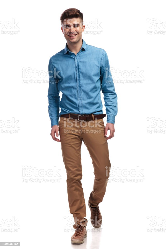 young happy casual man walking forward foto stock royalty-free