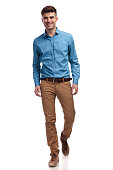 istock young happy casual man walking forward 935997166