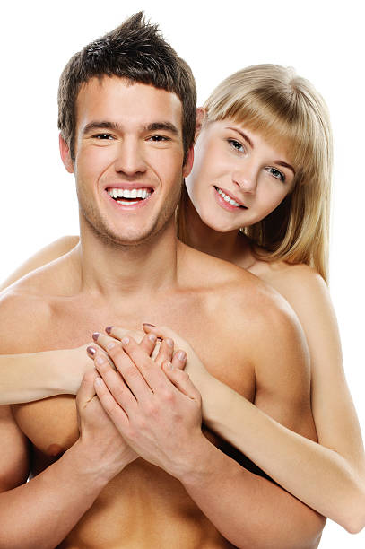 young happy couple against white background stock photo