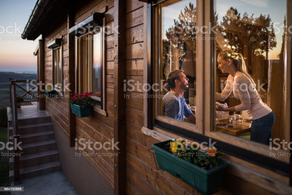Young happy couple enjoying the weekend in the chalet. royalty-free stock photo