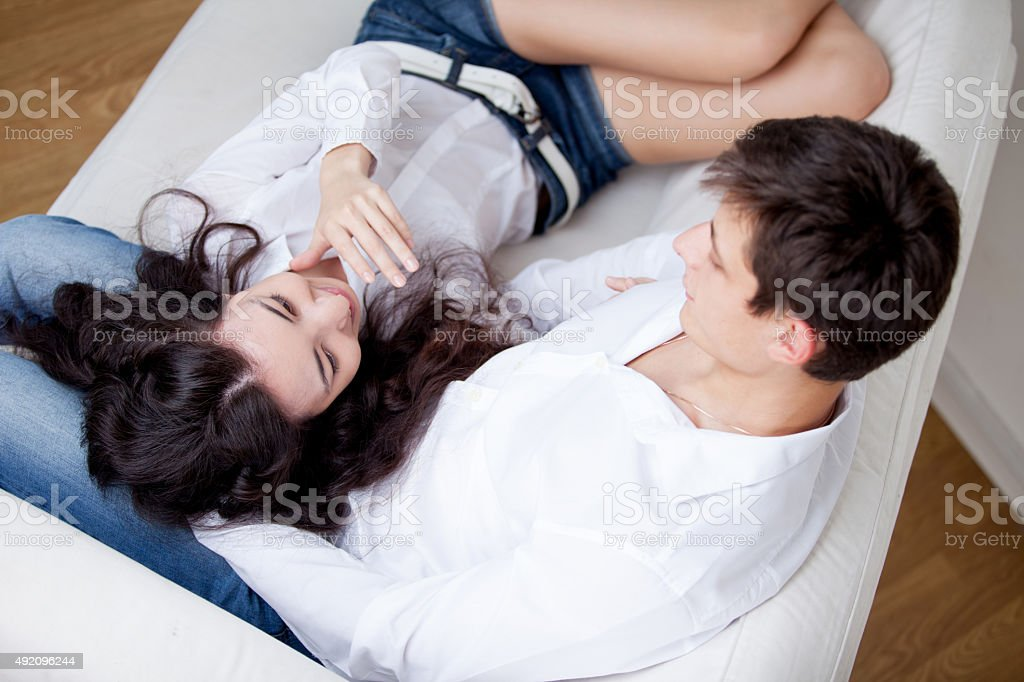 young happy couple,   girl lying on man's lap, lifestyle stock photo