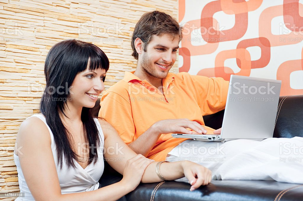 Young happy couple in the living room royalty-free stock photo