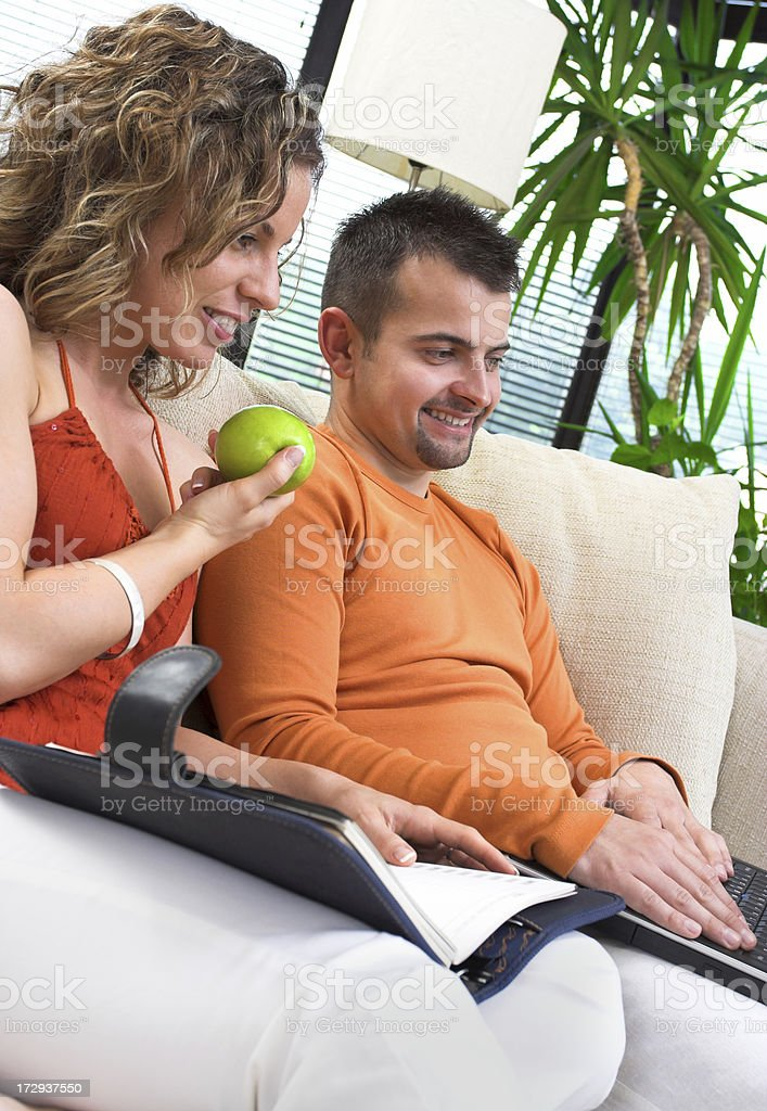 Young happy couple in the living room stock photo