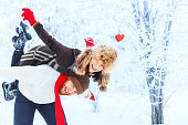 istock Young happy couple in winter forest 637915620