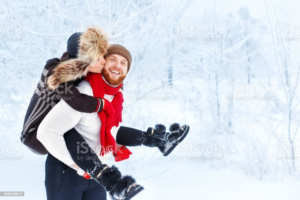 Young happy couple in winter outdoor stock photo