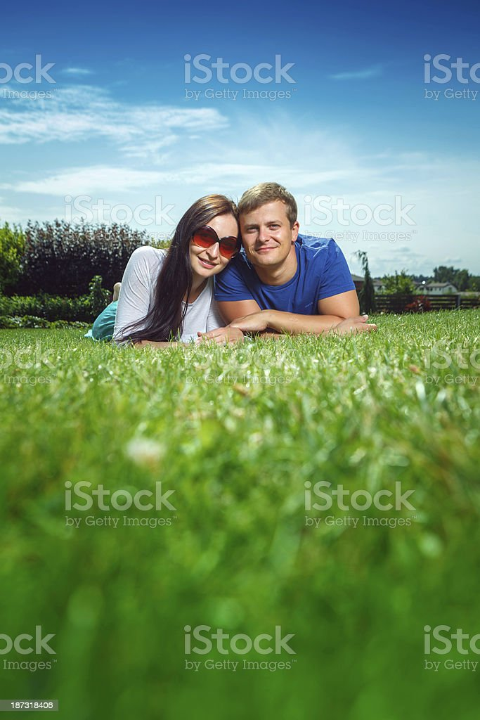 Young happy couple laying on the grass royalty-free stock photo