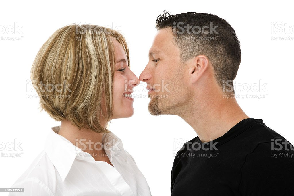 Young happy couple love face touching isolated on wiite royalty-free stock photo