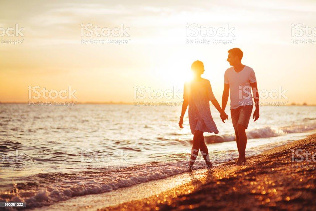 Young happy couple on seashore. stock photo