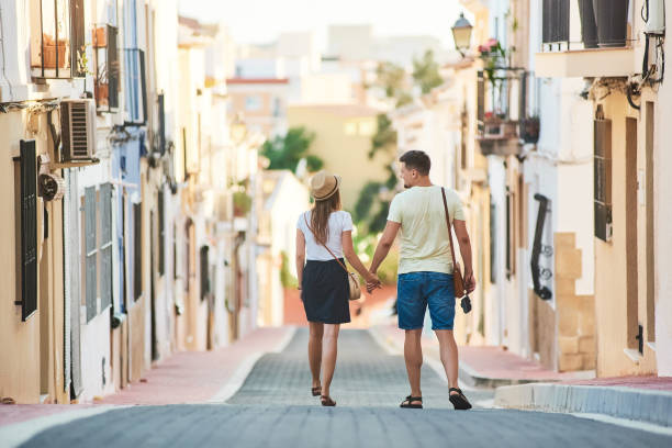Young happy couple walking in Spain stock photo