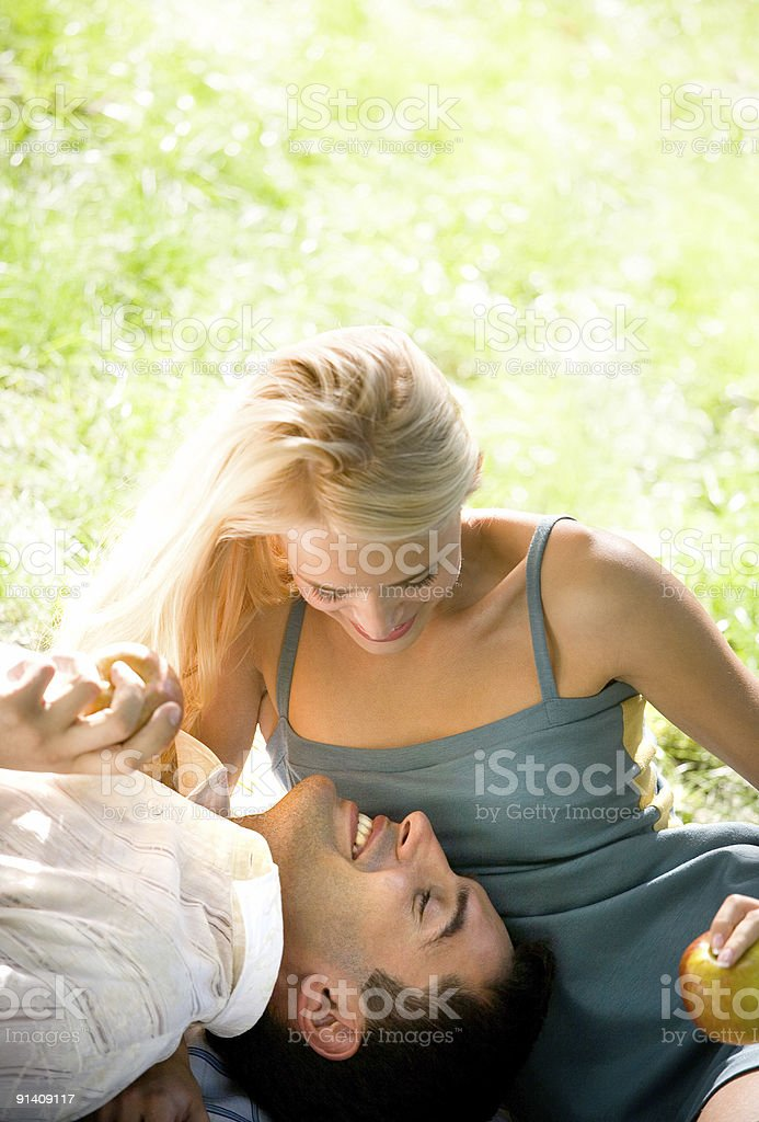 Young happy couple walking together at picnic, outdoors royalty-free stock photo