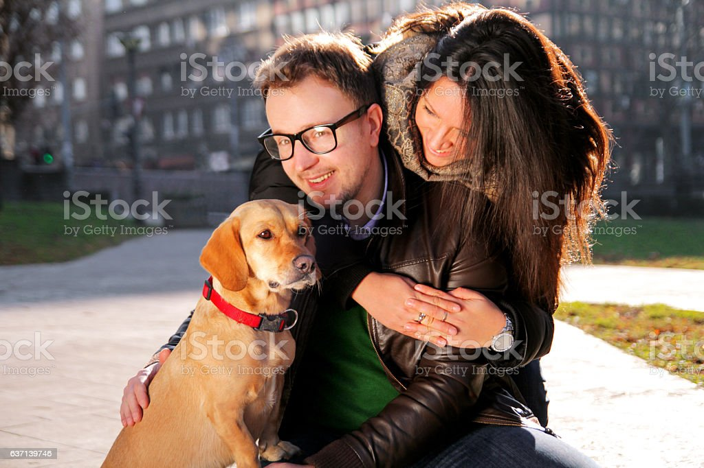 Young happy couple with dog enjoy in a beautiful day - foto de acervo