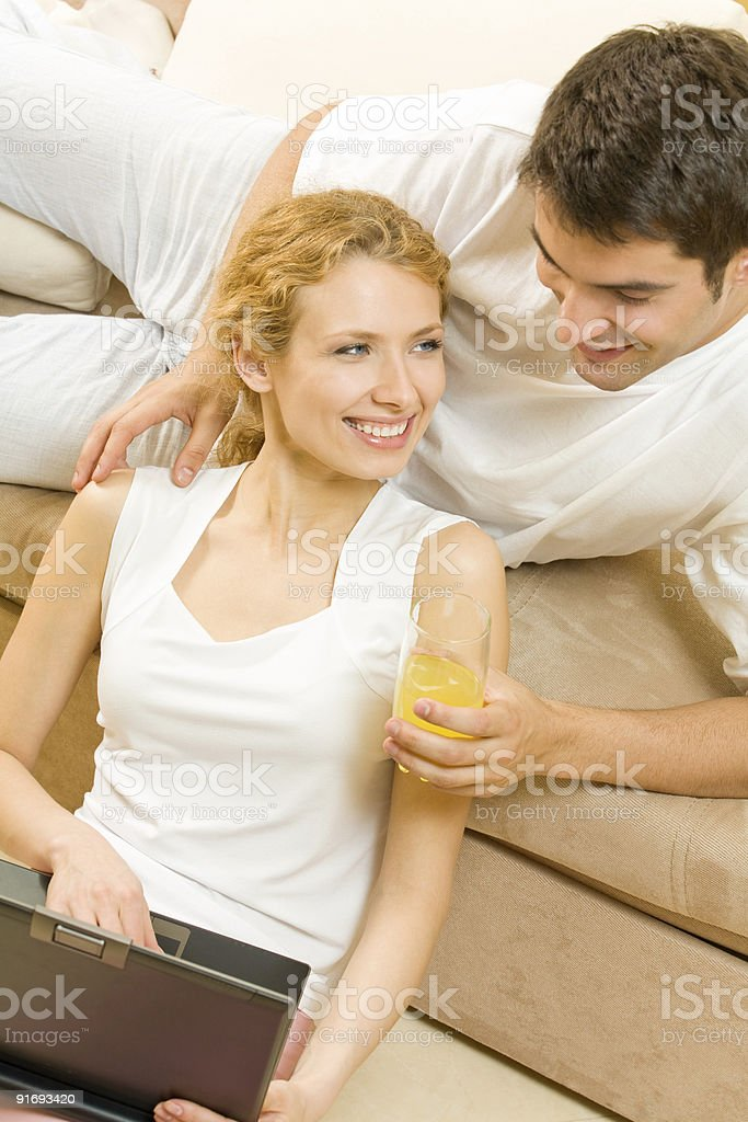 Young happy couple with laptop at home royalty-free stock photo