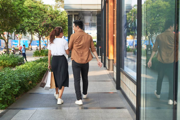Young happy couple with shopping bags in the city,having fun together Young happy couple with shopping bags in the city,having fun together shopping couple asian stock pictures, royalty-free photos & images