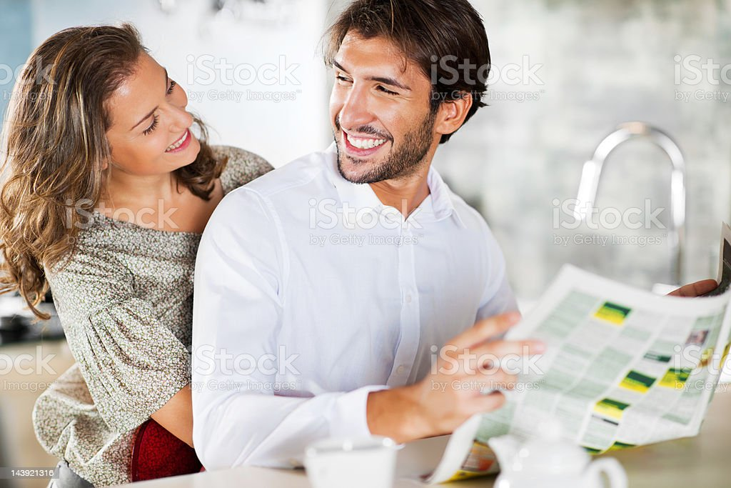 Young happy embraced couple enjoying at home. royalty-free stock photo