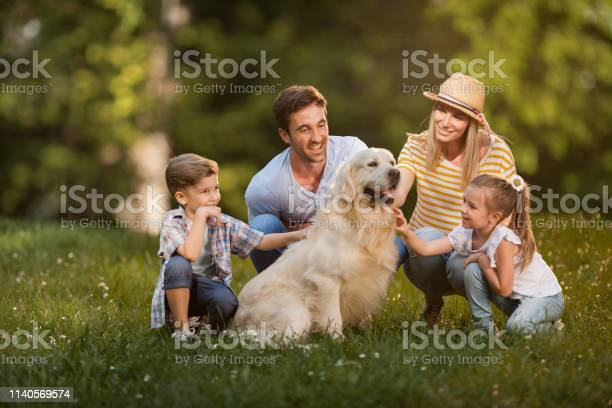 Young happy family and their golden retriever in the park picture id1140569574?b=1&k=6&m=1140569574&s=612x612&h=uk8zxqsftju om0jppkxaauxjudpwg mjiv2dmlsac4=