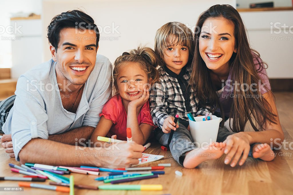 Young happy family drawing stock photo