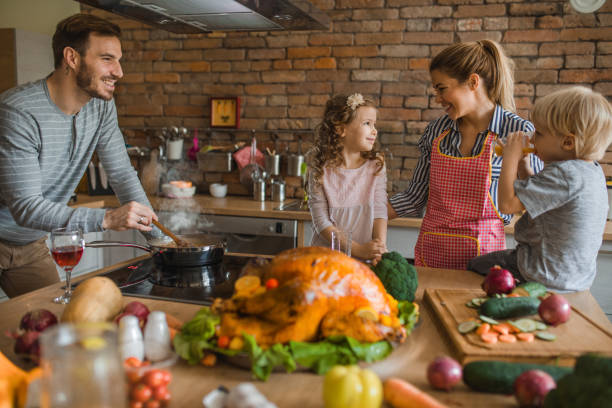 young happy family enjoying while preparing meal for thanksgiving in the kitchen. - christmas cooking imagens e fotografias de stock