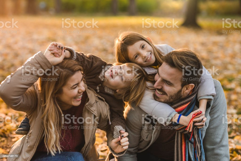 Young happy family having fun while spending an autumn day in nature. royalty-free stock photo