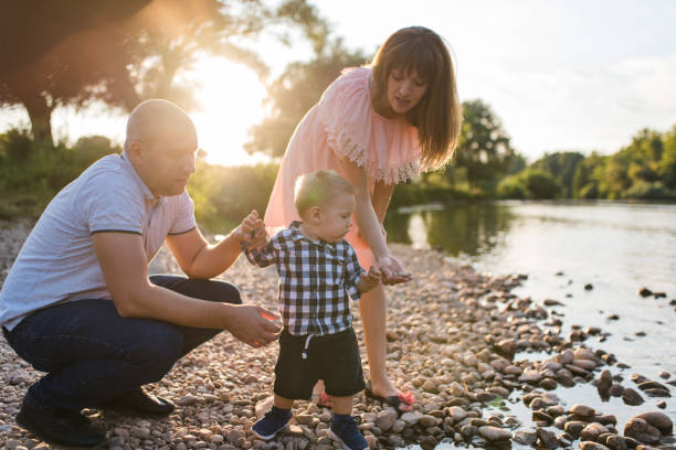 young happy family in the park - dtephoto stock photos and pictures