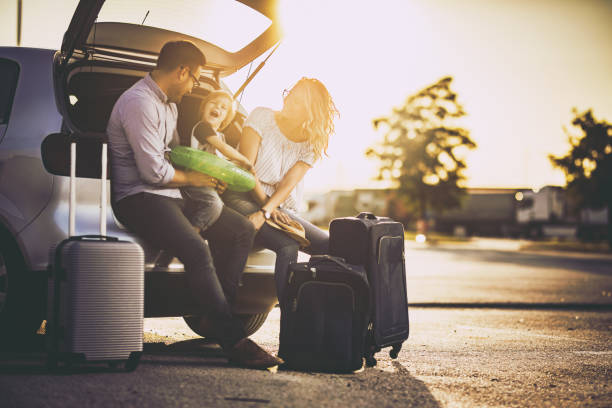 young happy family talking before a trip by car. - travel family stock photos and pictures
