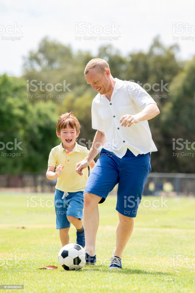 Young Happy Father And Excited 7 Or 8 Years Old Son Playing