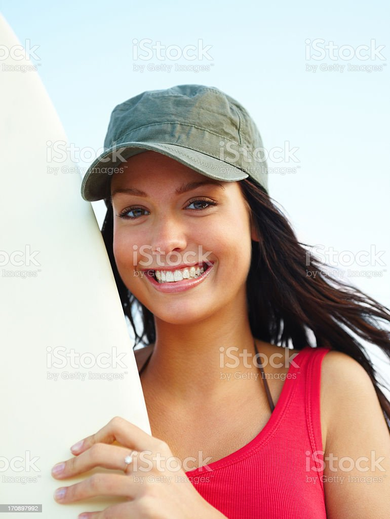 Young happy female surfer holding board royalty-free stock photo