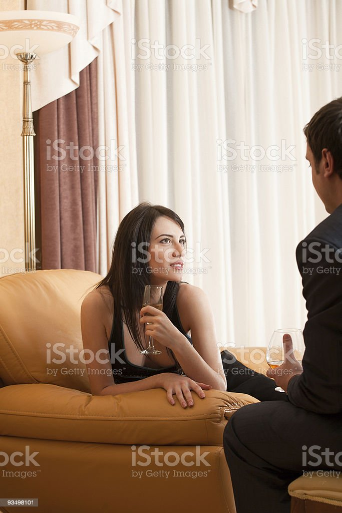 Young happy flirting couple with alcohol drinks royalty-free stock photo