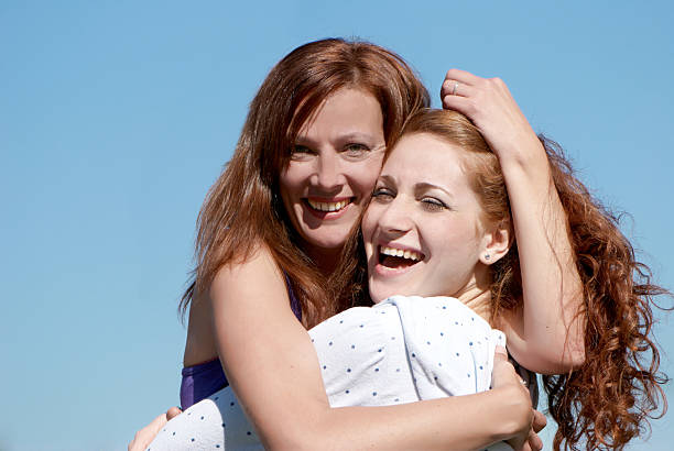 Young happy girl with mother stock photo