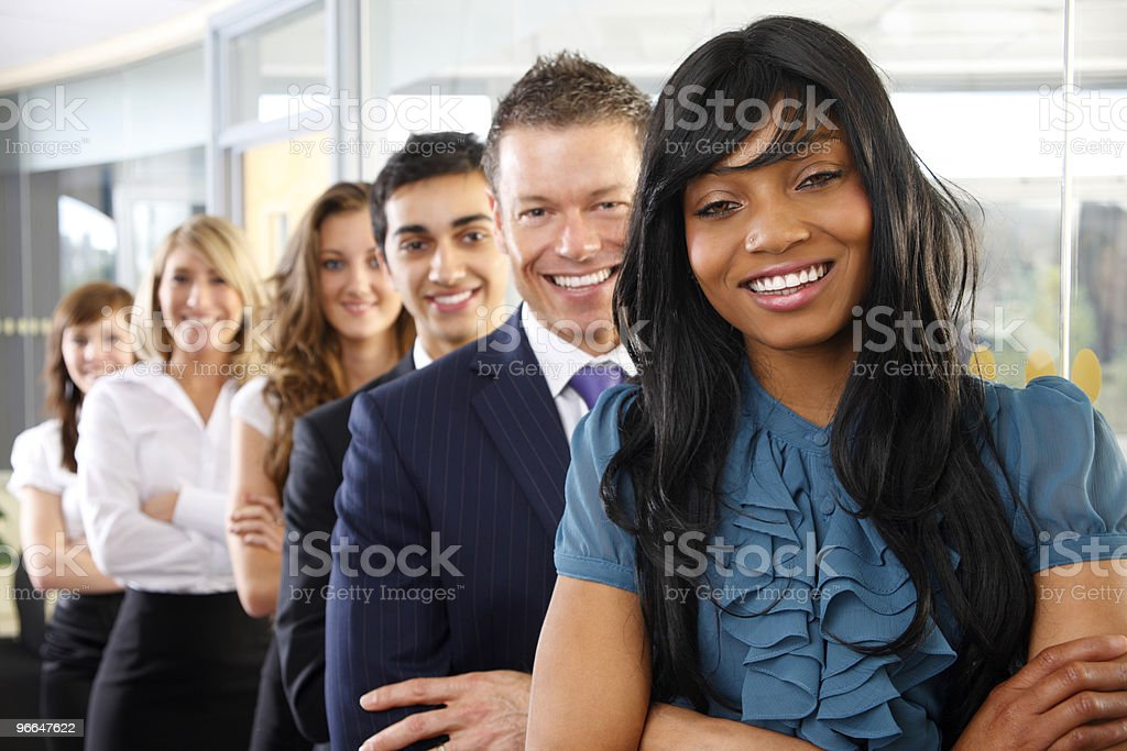 young happy Interracial Business group lined up in modern office royalty-free stock photo