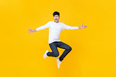 istock Young happy Korean teen jumping welcomely 1158086411