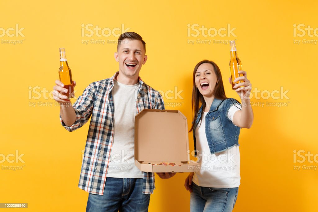 Young happy laughing couple woman and man sport fans cheer up support...