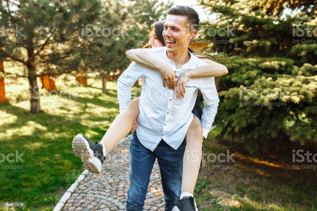 young, happy, loving couple, frolic and have fun in the Park, and enjoy each other, advertising, and inserting text royalty-free stock photo
