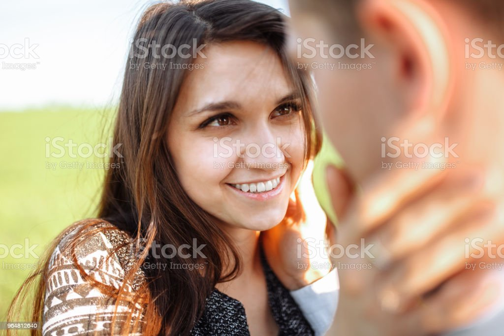 young, happy, loving couple, look at each other with tenderness , and enjoy each other, advertising, and inserting text royalty-free stock photo