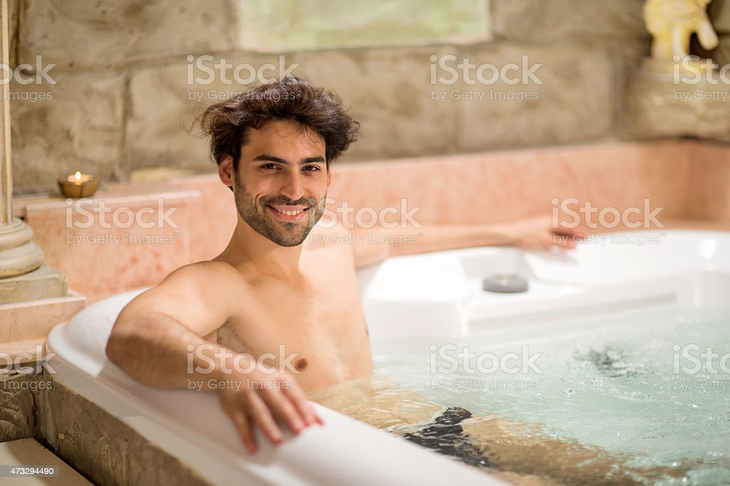 Young Happy Man Having A Hydrotherapy In A Jacuzzi Stock Photo ...