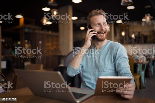 Young happy man having phone call in cafe picture id883161056?b=1&k=6&m=883161056&s=612x612&h=sjij3z22v59kqlo1ji0teuubxnz ixfjlyf2jk7uyoe=