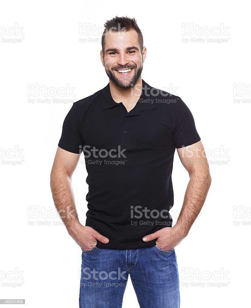 Young happy man in a black polo shirt stock photo
