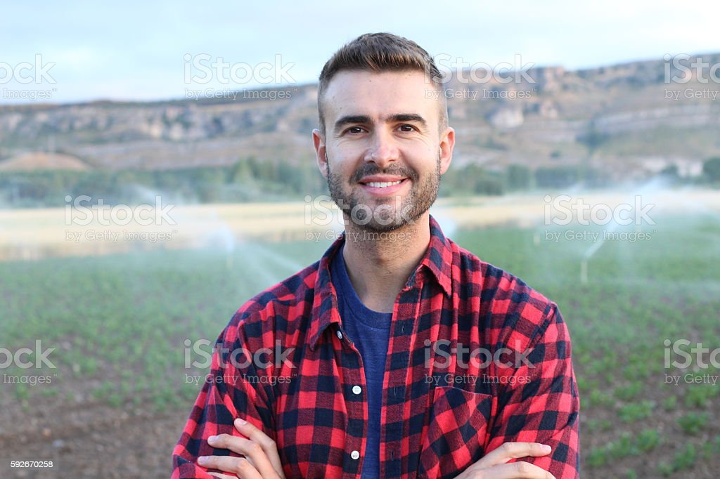 Young happy man smiling at camera in nature stock photo