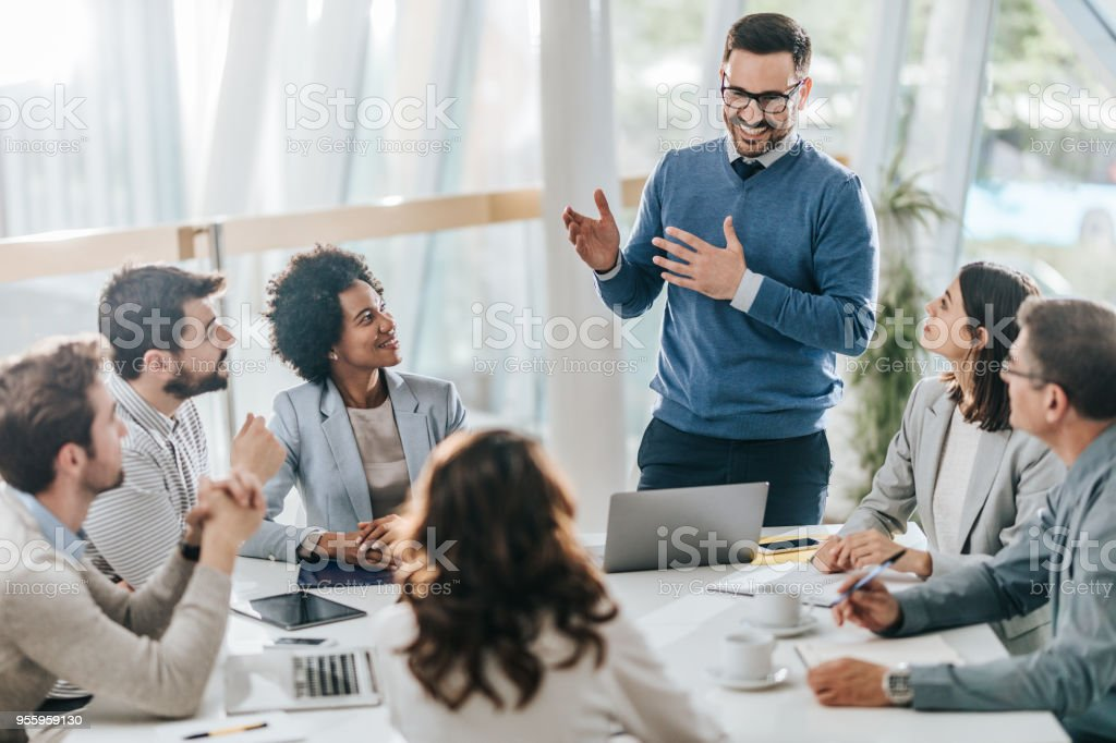 Young happy manager leading the meeting in the office. stock photo