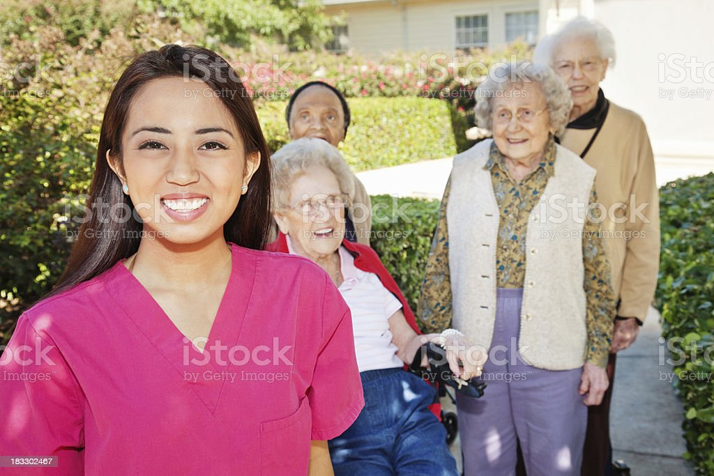 Young Happy Nurse With Her Senior Adult Patients royalty-free stock photo