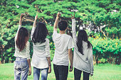 istock Young happy people celebrate in the public park. 1165972015