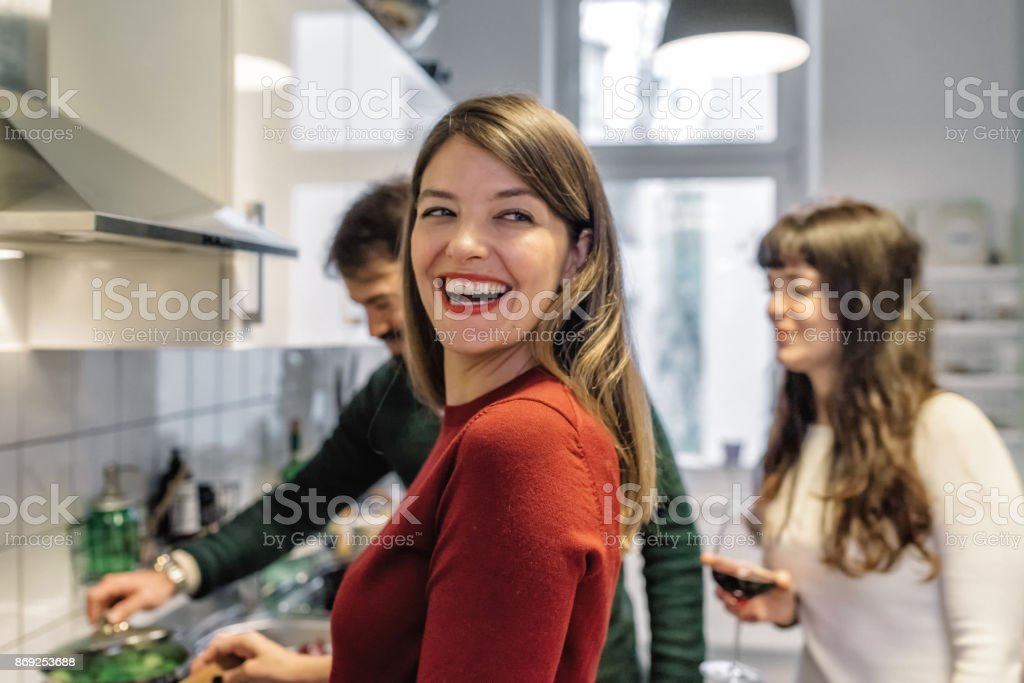 young happy people cooking together in kitchen stock photo