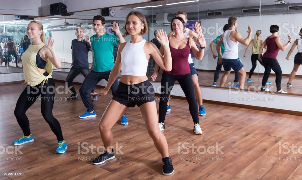 Young happy people dancing zumba elements stock photo
