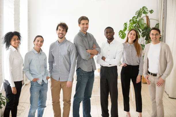 Young happy professional diverse people group or business team portrait stock photo