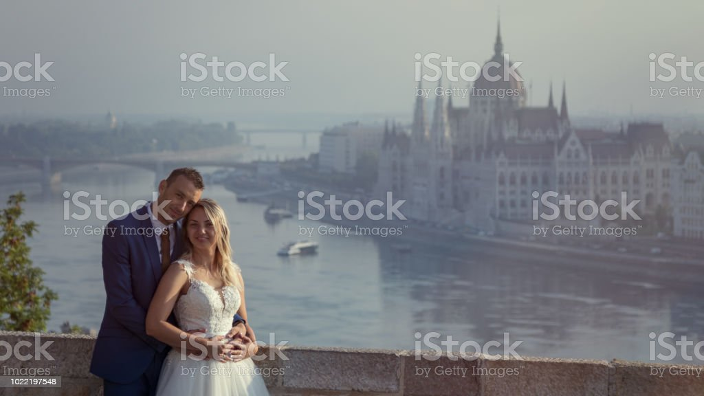 young happy romantic wedding couple outdoors in city stock photo
